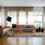 awesome Living Area Powerful decoration With Long Black Floral Fur Rug On Hardwood Flooring plus Gray Cloth Couch As Well Curtain Clear Cover The Window