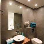 bathroom with perfect lighting white ceramic washbasin elegant style water closet