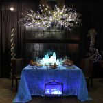 blue dining table with perfect lighting two romantic dining chair beautifull candelier