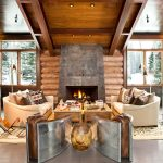 comfy living room elegan fire place with stoned mantel brown comfy sofa with funny cushion brown vernished wooden living room table elegant brown arc lamp dark grey ceramic floor