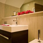 elegant-washbasin-modern-powder-room-brown-wooden-chest-of-drawer-bathroom-flower-pot-minimalist-bathroom-door