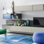 glasses-bay-window-dark-green-cozy-chair-blue-buffy-chair-bautifull-blue-puffy-chair-panltaion-vase-minimalist-wooden-cabinet-modern-bookshelf-blue-fur-rug-brown-wooden-floor-modern-arch-lamp-32inch-widescreen-televition