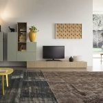 minimalist-arch-lamp-short-yellow-wooden-table-beautifull-fur-rug-soft-green-minimalist-cabinet-glasses-bay-window-classic-vernished-wooden-chair-beautiful-plantation-40inch-widescreen-televition-little-brown-jar-brown-wooden-laminated-floor