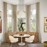 minimalist dining table brown fabric sofa brown curtain triple bay window elegan candelier laminated wooden floor