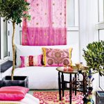 Inside Residence Decorations Concepts With Vegetation design Pink Color Curtain White Sofa plus Pink Cushions Pillow With Pink rug In White stained Wall Inside With Coffee Table