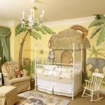 amazing baby girl nursary room elegant white crib  vicotorian sofa cute jungle wall painting theme rocking chair gorgeous green large curtain luxurious chandelier warm large carpet