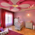 Amazing Ceiling Ideas With Wonderful Pink Color Accent Also Interesting White Crib And Small Cabinet With Low Sofa And Colorful Cushion In Laminate Flooring