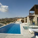 amazing hotel in greece with large swimming pool design also ravishing white lounge chair for sunbathing also wonderful wooden ceiling with flagstone patio