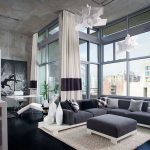 amazing modern masculine living room cozy warm black loft sofa wonderful large iron framed wall interesting office desk with hardwooden varnished flooring