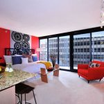 amazing studio apartment large glass window design sexy red beadboard wonderful cosy red sofa luxurious dining set furniture attracting photo frames glossy flooring style