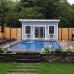 amazing swimming pool with gorgoeus square house decor and perfect lounge chairs and flagstone flooring with natural theme