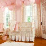 Astonishing Baby Girl Nursery Room With Interesting Japanese Inspired Pendant Lamps Also Wonderful Large Crib With Amazing Flower Motif Curtain In Lamiante Flooring
