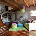 astonishing kids playroom in basement with gorgoeus brown couch also ravishing green rug with slide entrance also cute violet curtain in laminate flooring