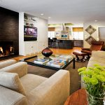 astonishing masculine living room with magnificent center wall brick fireplace also fresh lime cushion with rustic creamy sofa feat gorgeous kitchen area for modern house design