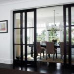 astonishing white and black room with gorgoeus framed sliding glass door divider with amazing brown dining sfurniture in glossy black painted flooring