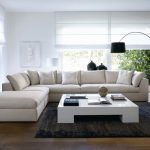 attracting l-shaped living room with comfortable large white sofa also wonderful floor lampt with elegant white wall paint ideas in hardwooden flooring design
