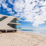beautiful azzure warm white sand vast blue ocean view contemporary house design glassed window modern design in Malibu confronting ocean view