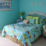 beautiful blue theme bedroom with green floor lamp comfy becover