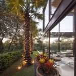 Big Pine Tree Large Glazed Panel Well Groomed Garden Beautiful Natural Landscape White Chairs White Painted Concrete Floor Geometric House Limanto Residence In Sao Paolo Brazil