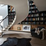black furry rug black upholstered rug black painted bookcase white painted ceiling wooden black painted desk English Oak treads whirling staircase modern staircase design