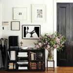 black painted interior doors black painted bookcase white painted wall wooden varnished floor hanging pictures potted flowers black umbrellas