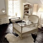 black painted wooden floor white crib white storage white changing station white small rocking chair white painted wall white floor lamp beautiful baby nursery room