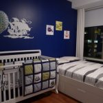 blue painted wall white painted crib white daybed wooden floor long standing mirror cute baby nursery room