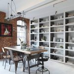 Brick Walls White Painted Ceiling White Painted Wooden Floor Industrial Metal Pendant Lamp Dark Gray Metal Dining Chairs Metal  Dining Table Built In White Painted Open Storages White Metal Ladder