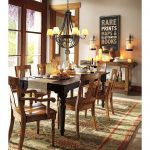 brown ceramic flooring wood dining chairs black wood dining table black elegant chandelier grey wall wide window with wood frame wall mounted glass candelabras wood side table beautiful plant patterned rug