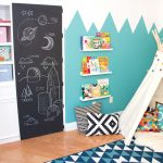 chalkboard door unique zigzag blue and white wall white teepee white cupboard with open shelves hardwood flooring blue geometrical rug colorful pillow metallic pillow bue and pink basket cases
