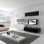 Classic Silver Sectional Sofa Set In Fashionable Living Area White Minimalist Desk On Gray Fur Rug As Well Tv Wall Mount Above Trundle Table Also Bookcase On The Wall