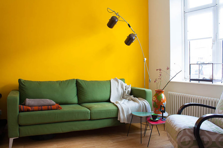 Contemporary Brown Floor Lamp Dark Green Sofa Sunny Yellow Wall White Wall  Pink Small Table Turqoise