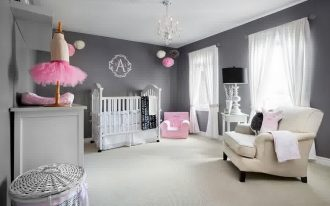 cute nursery room with neutral grey backdrop also elegant white craddle with goregous chandelier also cozy white armchair with wonderful rattan basket in white concrete flooring
