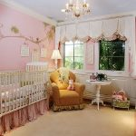 cute pinky nursery room with gorgeous trees decorative wall painting and elegant classic crib with golden accent on the sofa feat warm large ruh in a sexy chandelier lighting