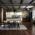 dark wooden floor wooden dining set light gray dining rug exposed industrial features bricked wall white kitchen cabinets gray marble countertops industrial design style dining room