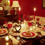 dark wooden varnished dining table dark wooden varnished dining chairs red painted wall beautiful red drinking glass love shaped cake glass candlestick white fringed napkin red candle