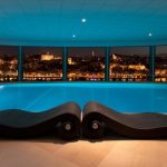 elegant Gentle Lighting Ceiling Above Pool plus Black Sleeper Couch On Brown Tile Ground Wonderful Swimming Pool Design Glasses Wall Concept