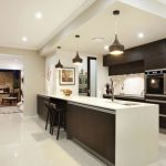 elegant Long Island On Small Kitchen Design Also Uncovered Bricks Fireplace Industrial Pendant Lamps also Black Cupboards