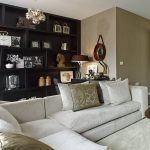 elegant contemporary architecture with cozy white sofa also wonderful large open cabinet and interesting brown wall paint ideas with round coffee table feat warm fur rug