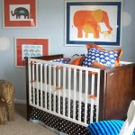 elegant nursery room theme with gorgoeus white and brown wooden crib also decorative elephant painting and amazing blue wall decal in large carpet ideas