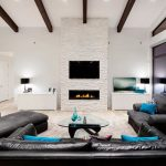 enchanting living room with turquoise cushion and wonderful ceiling with long teak wood design also interesting wall mount fire place in laminate flooring