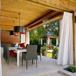 fascinating wood patio black hanging lamp granite flooring black chairs with red cushion white table black sconce white outdoor curtain ligh grey pots