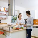 fresh and organic fruits freash vegetables wooden countertop white cabinets  white painted wall  beautiful white pendant lamps healthier and greener kitchen