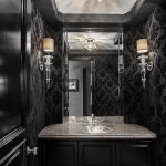 gorgeous black bathroom with amazing black flower wallpaper also luxurious wall light and chandelier with granite top vanities in hardstone flooring