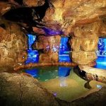 gorgeous indoor swimming pool with cave tube theme also interesting flagstone pathaway for classic house design