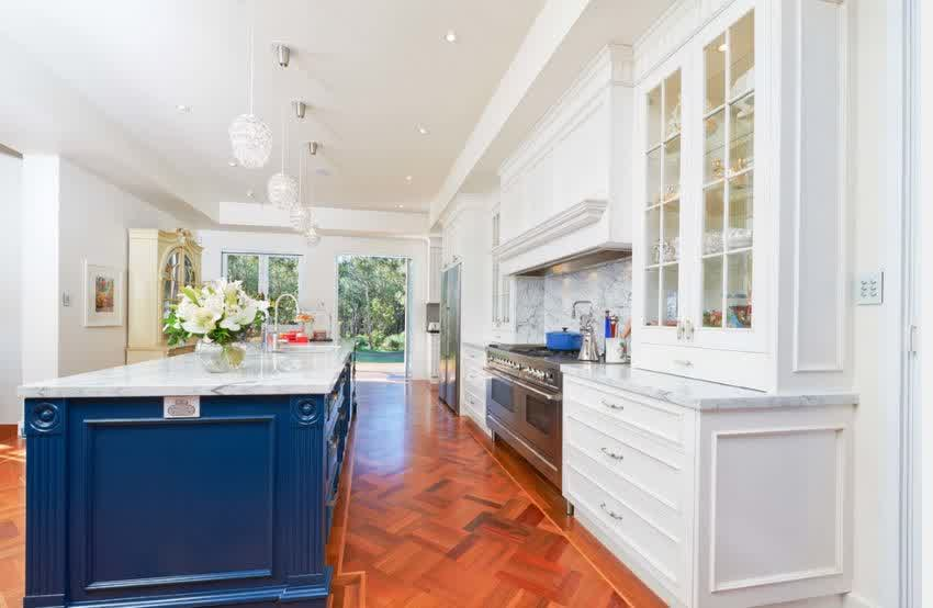 gorgeous kitchen design ideas with magnificent radiant blue cabinet and wonderufl crystal pendant lighting in laminate flooring concept