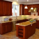 great Stone Countertop plus Flooring Tile also Double Pendant Lamps Brown Wood Cupboards Small Galley Kitchen Design