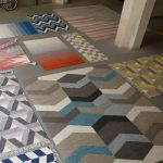 grey concrete flooring blue bicycle white concrete post beautiful blue-white-grey geaometric rug white-orange stripped rug white-blue stripped rug abstract rug