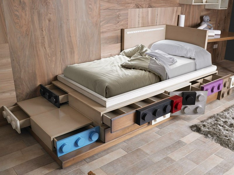 hardwood flooring wood wall grey rug wood side table unique bed with hidden storage white pillow white bed sheet grey bed cover drawers with colorful lego handle