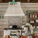 inspiring white cabinet dark granite countertop white wood board wall raw wood beams white ceiling brick tile flooring black stained wood dining chair wood dining table teal cupboard green hanging lamp